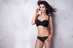 Sensual brunette woman looking at camera. Royalty Free Stock Photography