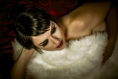 Sensual brunette woman lying naked. On red silk, detail Stock Photography
