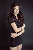 Sensual brunette woman Model with long curly hair, in dress, iso Royalty Free Stock Photography