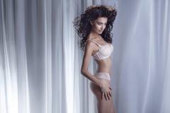 Sensual brunette woman posing in lingerie. Royalty Free Stock Image