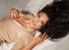 Sensual brunette woman relaxing Royalty Free Stock Image