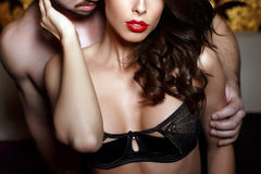 Sensual brunette woman in underwear with young lover closeup Stock Images
