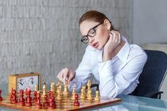 Sensual businesswoman moving winning combinaton Stock Images