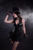 Sensual cabaret girl in fetish dress and tophat Stock Image