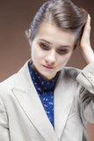 Sensual Caucasian Girl in Jacket and Blue Shirt Touching Hair and Looking Down Royalty Free Stock Photo