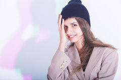Sensual Caucasian Girl Touching Warm Hat and Looking Curiously at Viewer Royalty Free Stock Image