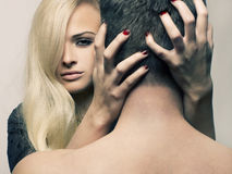 Sensual couple. Beautiful passionate girl hugging a men by the neck Royalty Free Stock Photo