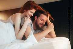 Sensual couple in bed being romantic Royalty Free Stock Photos