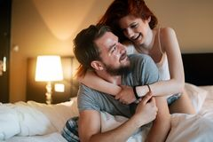 Sensual couple in bed being romantic stock images