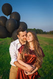 Sensual couple embracing in a field Royalty Free Stock Images