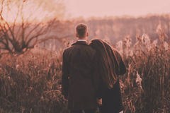 Sensual couple in a field. She put her head on the man's shoulder royalty free stock photos