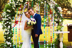 Sensual couple in flower arch. On nature Royalty Free Stock Photos