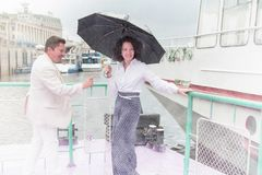 Sensual couple middle-aged man woman umbrella true love feelings stock photography