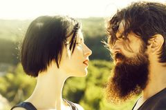 Sensual couple on nature. Sensual couple of women beautiful brunette short hair and men handsome bearded on sunny day on nature royalty free stock photography