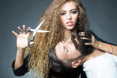 Sensual couple posing with scissors Royalty Free Stock Photography
