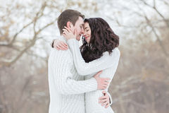 Sensual couple in snow Royalty Free Stock Image