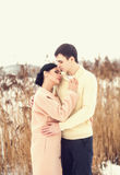 Sensual couple in winter field Royalty Free Stock Image