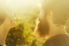 Sensual couple in sunlight. Sensual couple of women beautiful brunette short hair and men handsome bearded in sunlight on nature stock photos