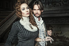 Sensual couples. Beauty couples in the vintage room Stock Image