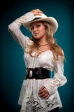 Sensual Cowgirl. Sensual woman cowgirl posing with hat and smiling Stock Image