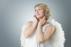 Sensual dreaming angel Stock Photo