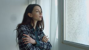 Sensual dreaming woman looking out window stock video footage