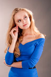 Sensual dreaming young blonde girl touching ear Stock Images