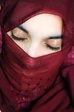 Sensual eastern, asian, arabic woman, glamure. Under the scarf Stock Photos
