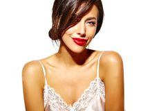 Beautiful happy cute sexy brunette woman with red lips in pajamas lingerie on white background Royalty Free Stock Image