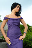 Sensual elegant woman. Gorgeous sensual elegant woman posing in the park in an off the shoulder dress Royalty Free Stock Image