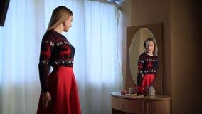 Sensual elegant woman near the mirror stock video