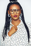 Stylish black woman in goggles touching button on cloth Stock Photography
