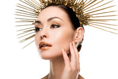 Sensual elegant woman wearing golden headpiece. Isolated on white Stock Images