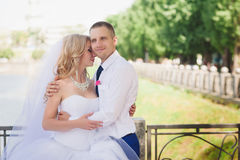 Sensual embrace bride and groom in the light of sunset Stock Images