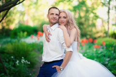 Sensual embrace bride and groom in the light of sunset Stock Image