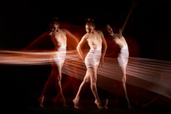 The sensual and emotional dance of beautiful ballerina Stock Photos