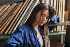 Sensual portrait of a young beautiful girl female artist royalty free stock photography