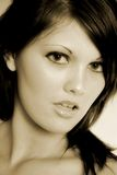 Sensual face. Female with a pretty face and sensual stare. image is sepia toned Royalty Free Stock Image