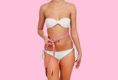 Sensual female body with white bikini anda tape measure Stock Images