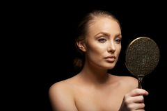 Sensual female model looking in make up mirror Stock Photography