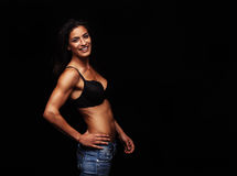 Sensual female model posing in bra and jeans Stock Photo