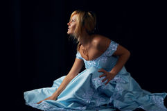 Sensual fiancee in blue dress. Over black royalty free stock images