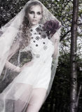 Sensual fiancee in wedding dress posing royalty free stock photo