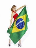 Sensual football supporter holding Brazil flag Stock Image