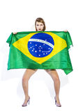Sensual football supporter holding Brazil flag and looking Stock Photography