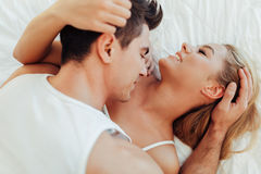 Sensual foreplay in bed Royalty Free Stock Photography