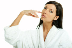 Sensual and Fresh. Portrait of Fresh and Beautiful brunette woman on white background wearing white bathrobe royalty free stock images