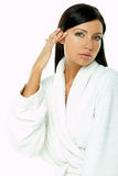 Sensual and Fresh. Portrait of Fresh and Beautiful brunette woman on white background wearing white bathrobe royalty free stock image