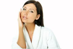 Sensual and Fresh. Portrait of Fresh and Beautiful brunette woman on white background wearing white bathrobe stock photo