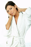 Sensual and Fresh. Portrait of Fresh and Beautiful brunette woman on white background wearing white bathrobe stock photos
